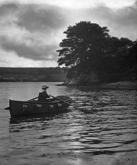 Veronica (Major Gill's wife) rowing in a creek off the River Fal, Cornwall