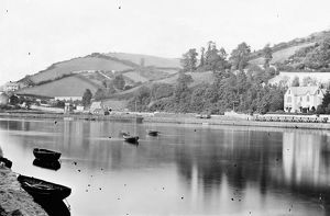 View from Looe Bridge across the river estuary, showing part of the Liskeard to Looe branch railway line on the opposite bank. Around 1880s