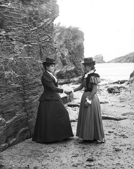 Two women below the cliff at Trevone, Padstow, Cornwall. Probably 1890s or early 1900s