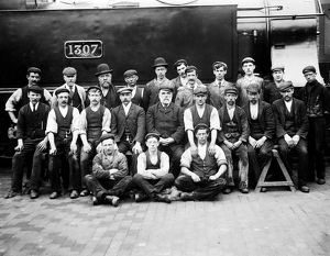 Workers in front of locomotive GWR 1307. Possibly around 1895