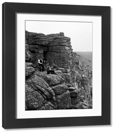 John Charles Burrow and Herbert Hughes with camera on cliff side. Photographer: Unknown