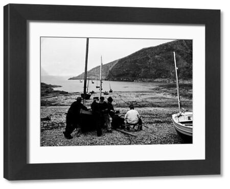 Fishermen with boats on the beach. Photographer: Herbert Hughes