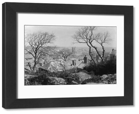 View over St Ives through trees towards the church. Photographer: Unknown