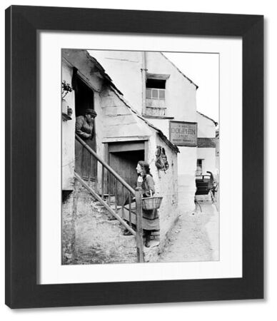 Showing The Dolphin Inn, Proprietor: Robert Horwill. The girl on the steps is Lilly Worden and the woman in the doorway is Rachel Thomas. Photographer: Herbert Hughes