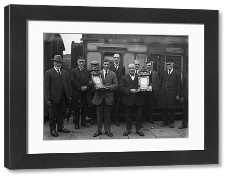 A group photograph showing a presentation to two men who tried to save a railwayman. The photo was published in the West Briton on 21st August 1924 but there was no accompanying article. Photographer: Arthur William Jordan