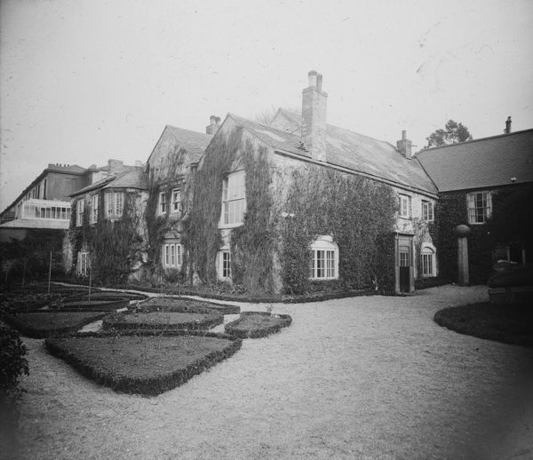 Home of the Killigrew family for four centuries. Glass lantern slide from a lecture, entitled 'Some Historic Cornish Beauty Spots', given by Cornishman and amateur photographer, Major Arthur William Gill, in around 1925. He was well known in Cornwall