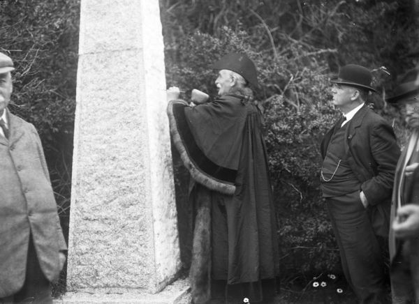 J. Tonkin, the Mayor, recutting the letters TB in a Boundary stone