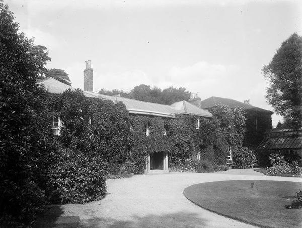 Front elevation of the Grade II listed house and conservatory, taken from the garden. Photographer: Arthur William Jordan