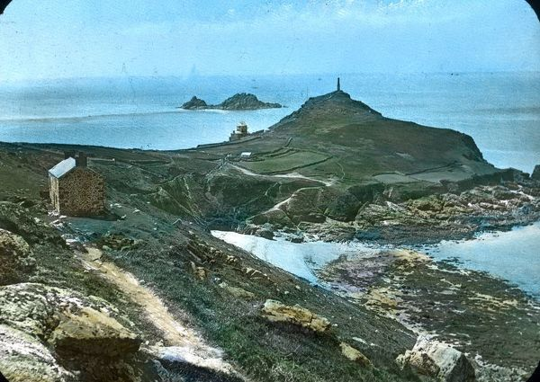 Hand coloured glass lantern slide showing Cape Cornwall from the NE side, above Porth Ledden (Porthledden). Wheal Call Counthouse can be seen on the left. The Brisons, which lie about a mile from the mainland, can be seen immediately to the left of the cape