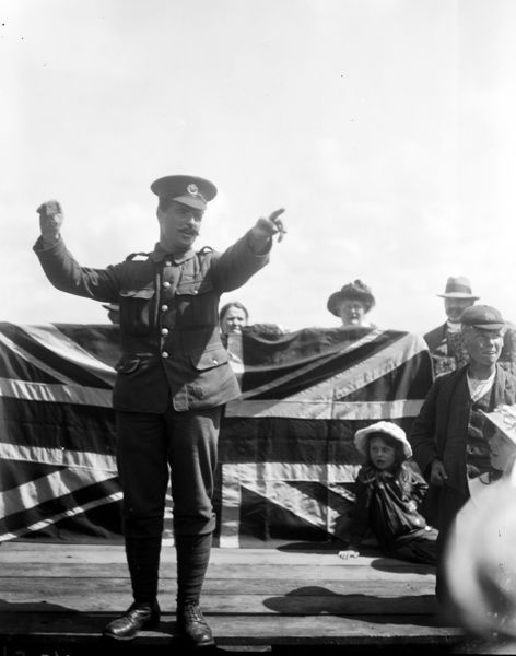 Picture of Thomas Rendle (born Bedminster, Bristol on the 14th December 1884), speaking to a crowd during a campaign march. At the time of his award he was a bandsman in the 1st Battalion, Duke of Cornwall's Light Infantry and was acting as a stretcher bearer