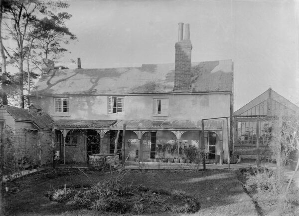 A view of the rear of 'The Cottage', a house in Fore Street near the entrance to the former Probus School. Photographer: Arthur William Jordan