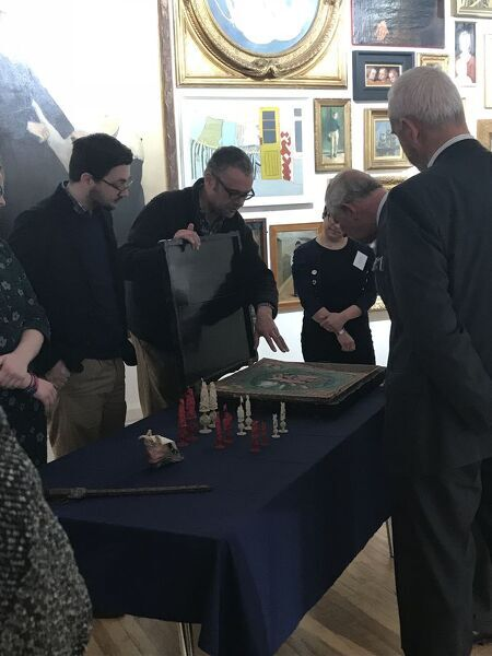 The museum's Citizen Curator volunteers discuss some of the objects they researched as part of their training with the Duke of Cornwall in the Treffry Gallery