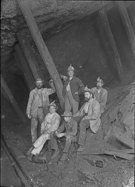 Group of miners in the 70 level, including the photographer's wife and son. Photographer: John Charles Burrow