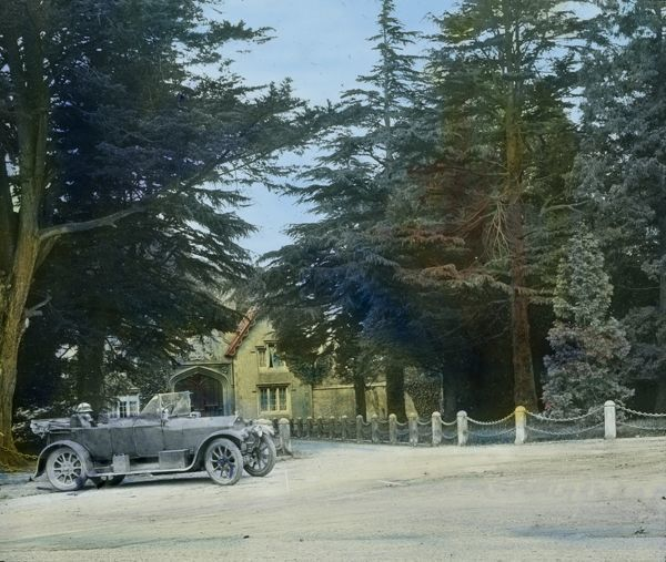 Tregothnan was home for five centuries of the Boscawen family. Major Arthur William Gill's car is in the foreground. Glass lantern slide from a lecture, entitled 'Some Historic Cornish Beauty Spots', given by Cornishman and amateur photographer