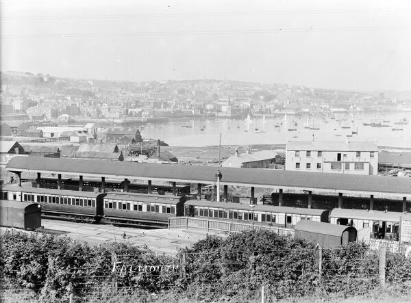 A view of the platform at Falmouth Railway Station with a train in, looking towards the harbour and the town. Photographer: Unknown