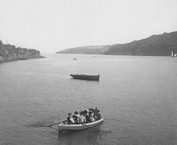 Ferryboat in midstream, probably off the Helford passage. There are several passengers including a child. Photographer: Unknown