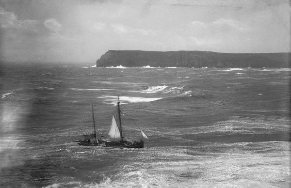 Fishing boat in rough sea approaching the Camel Estuary, Padstow, Cornwall. Early 1900s