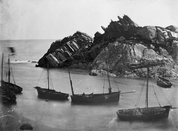Fishing boats off Chapel Rock, Polperro, Cornwall. Probably 1860s-1870s