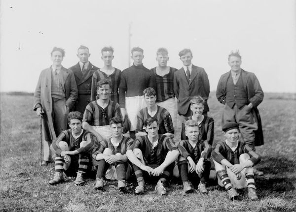 A view of the Probus football team, taken around 1930. The donor's grandfather, Leslie George Champion is thought to be in the photograph. Photographer: Possibly Opie Ltd of Redruth