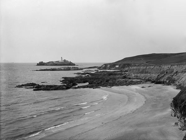 Godrevy lighthouse and headland from the west. The lighthouse was built on Godrevy Island in 1859. Photographer: Herbert Hughes