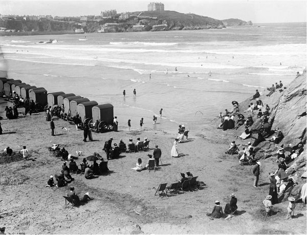 A view of crowds on the Great Western Beach with the headland and The Headland Hotel in the background. Photographer: Unknown