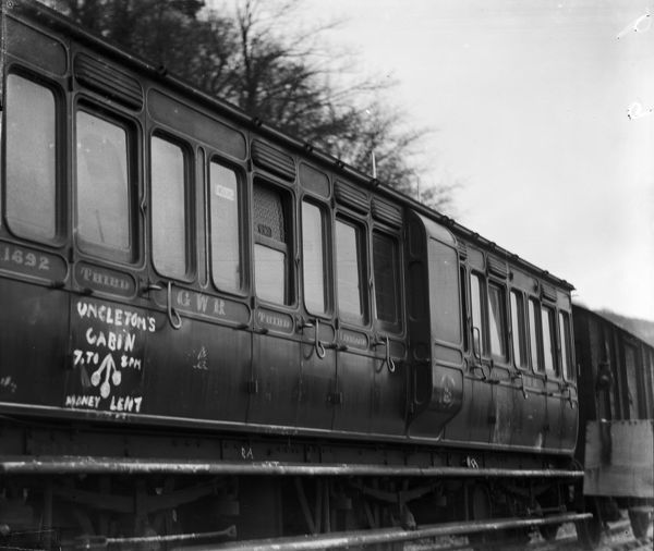 A Great Western Railway 6-wheeled clerestory 3rd class coach No. 1692. This particular coach was used in the Fowey strike in 1912. Graffiti can be seen which reads 'Uncle Tom's Cabin, 7 to 8pm, Money lent'. Photographer: Arthur William Jordan