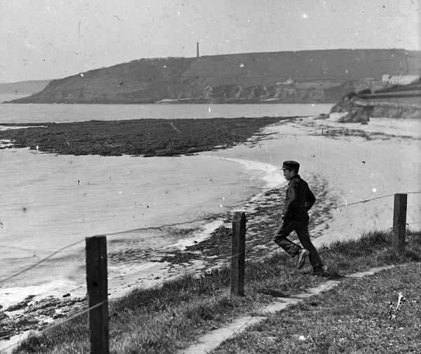 Young boy, with a mine stack on the headland. Taken from Pendennis