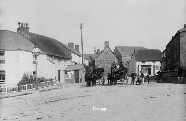 The Square looking north towards Chapel Street with the Jubilee Lamp on the left. Two horse buses stand outside the Post Office with passengers aboard. The one on the left is Albion and the other is Magnet which travelled the Grampound-St Austell-Truro route