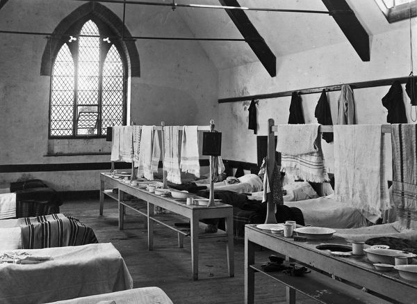 A view of the dormitory of Probus School which was founded for the middle classes of Cornwall in 1852. The photograph shows beds, tin wash bowls, mugs and towels. Photographer: Ernest Charles Argall