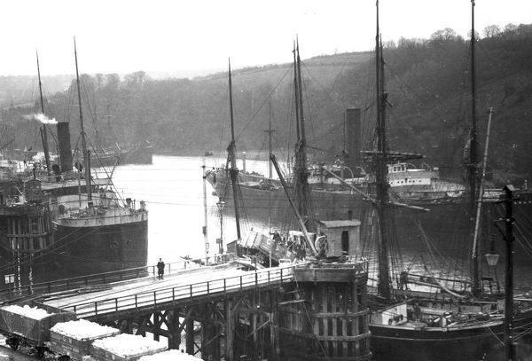 Loading clay into a schooner at Fowey Harbour, Cornwall ...