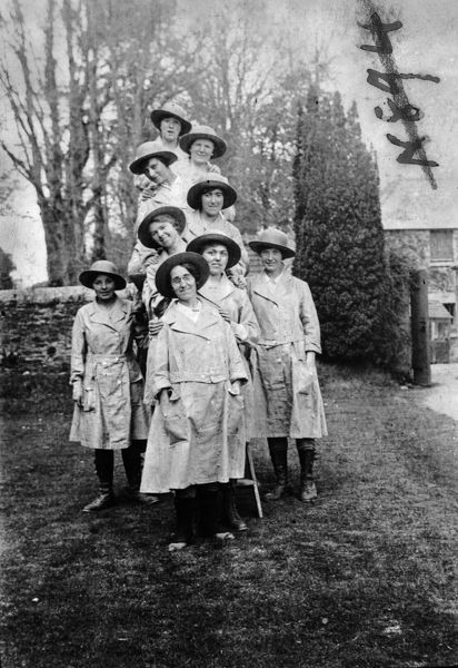 Members of the Women's Land Army standing on and around a ladder