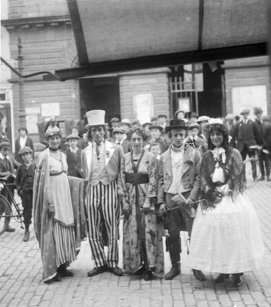 Miss Ade Thomas' pierrot troupe outside Truro City Hall, for a fete in aid of wounded soldiers and sailors. Photographer: Arthur William Jordan