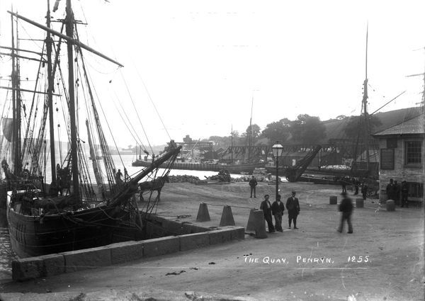 Penryn Quay with the ketch 'Hobah' alongside the granite works quay in the middle distance. This vessel was built at Mylor and owned in Penryn. An unidentified schooner unloads in the foreground. Photographer: Arthur Philp