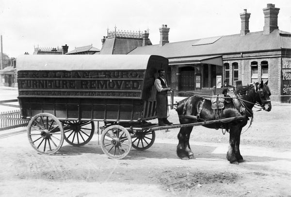 Great Western Railway agent R & J Lean, furniture remover waiting outside Truro Railway Station on a horse-drawn covered waggon. The business is listed in Kelly's directory from 1893 to 1926