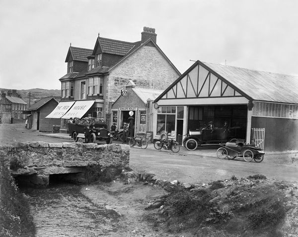 The Red House Restaurant and Donald Healey's Garage with a fully laden charabanc AF 3771 outside and three other vehicles including a small 'sports car' and two motor bikes