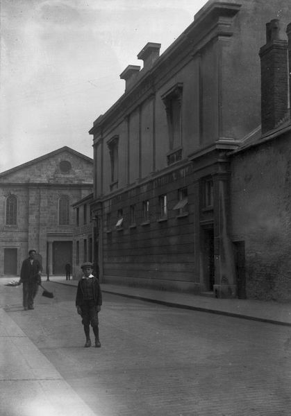 Former Royal Cornwall Museum building looking east with St Mary's Methodist Chapel in the distance, Union Place, Truro. Around 1910