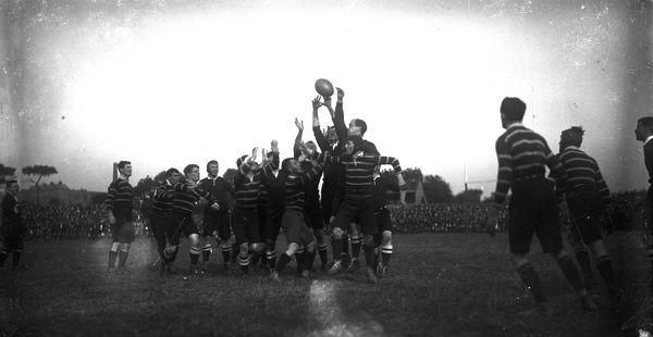 A match between Cornwall, in the striped jerseys, and the touring South African Springboks team at Redruth. The picture shows a line out during the match. The Springboks went on to win the match 15-6. Photographer: Unknown