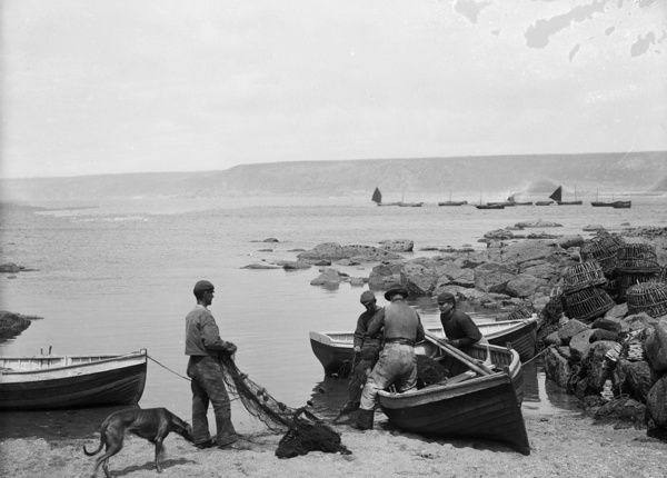 Fishermen with boats and nets. Photographer: Herbert Hughes