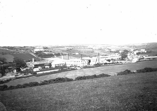 A general view of Tregaseal (Tregeseal) looking up the valley with the foundry buildings in the middle ground of the picture