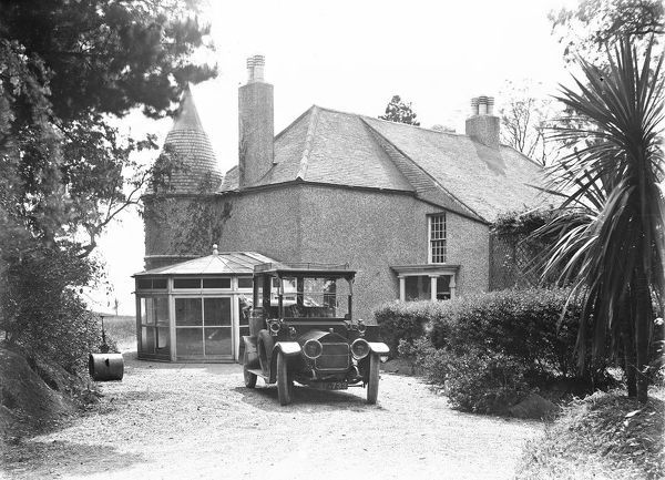 Tregorland House showing the conservatory to the side. A car with the registration number AF-733 stands on the drive. Photographer: Arthur William Jordan