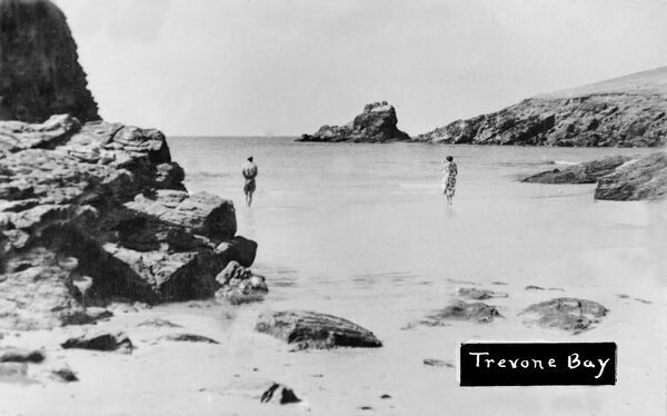 A view, looking towards Roundhole Point, of a man and woman on the beach, near the water's edge. Photographer: Unknown