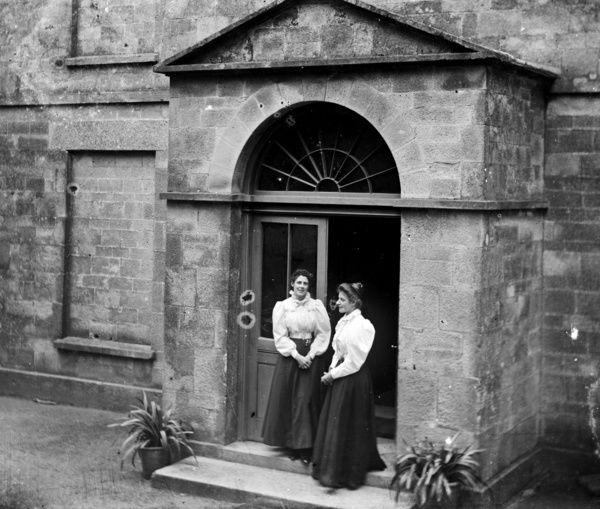 Two ladies, presumably members of the Jenkin family, standing in the porch