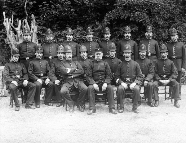 A group of Truro police photographed outside against a backdrop of trees. Photographer: Unknown