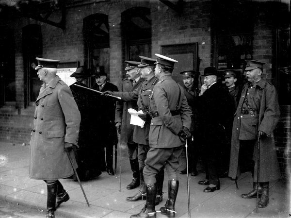 Arrival of army chiefs at Truro Railway station ahead of an inspection of a combined parade of the Cornish volunteer regiments. Standing far right is Col. John Jeffery of Truro (grandfather of A.J. Lyne). Photographer: Arthur William Jordan