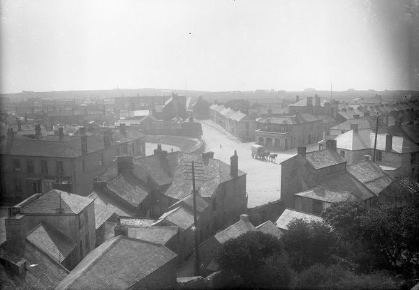 A view of Churchtown from the top of the church tower towards the Consolidated Bank of Cornwall, Plain-an-Gwarry and Cape Cornwall Street with a horse-drawn vehicle by the Consolidated Bank. Photographer: Unknown
