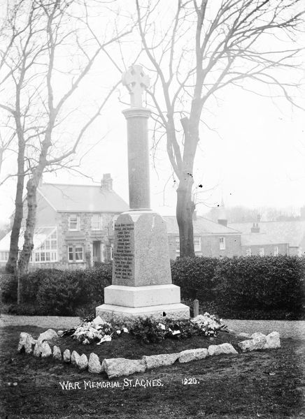 Newly erected War Memorial in British Road, St Agnes, surrounded by floral tributes. Photographer: Unknown