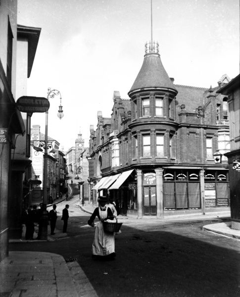 On the corner is the outfitters shop belonging to H.W. Rippon (late J. Evans & Co.). Part of the A.K. Hamilton Jenkin collection. Photographer: Unknown