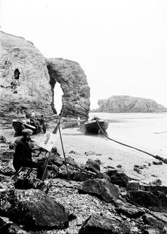 Artist at Arch Rock, Perranporth, Cornwall. Early 1900s