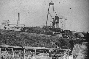 Two Engine houses at Wheal Sparnon with cottages in the background, Redruth, Cornwall