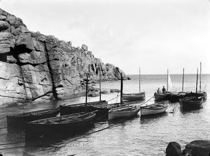 Two fishermen standing in their boat offshore, Porthgwarra, Cornwall. 1898